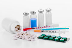 Pharmacology tablets vials syringes Stock Image