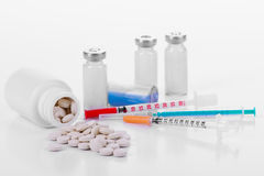 Pharmacology tablets vials syringes Royalty Free Stock Image