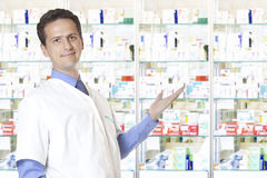 Pharmacy. Portrait of mid adult pharmacist looking at camera in pharmacy stock images