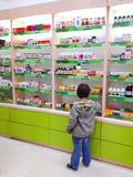 Pharmacy. Inside Plafar pharmacy Romania. Child looking at shelves royalty free stock photos