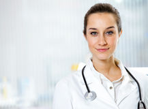 At pharmacy. Portrait of  smiling young woman pharmacist with stethoscope Royalty Free Stock Photography