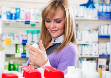Pharmacy. Portrait of blonde woman doing shopping in pharmacy Stock Images