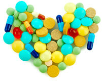 Pharmacy background. Some different pills as a form heart Royalty Free Stock Photography