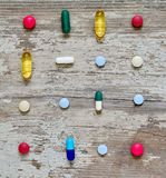 Pharmacy background. Pills on a wooden table. Medicine. Medicine pills in packs.Pills in blister pack Stock Images