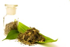 Pharmacy bottle, with herbal. Pharmacy bottle, with herbs. Herbal tea on the leaf stock photos