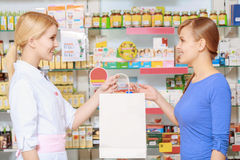 Pharmacy chemist and customer at the drugstore Royalty Free Stock Photo