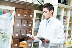 Pharmacy chemist man in drugstore Royalty Free Stock Photos