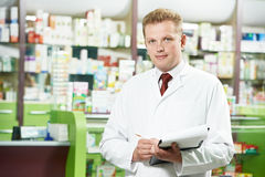 Pharmacy chemist man in drugstore Stock Photo