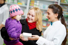 Free Pharmacy Chemist, Mother And Child In Drugstore Royalty Free Stock Images - 21873269