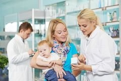 Pharmacy Chemist, Mother And Child In Drugstore Royalty Free Stock Photos