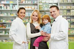 Pharmacy chemist, mother and child in drugstore Royalty Free Stock Photo