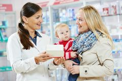 Pharmacy chemist, mother and child in drugstore Stock Photo