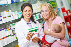 Pharmacy chemist, mother and child in drugstore Stock Images