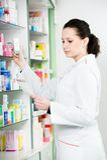 Pharmacy chemist woman in drugstore stock image