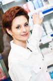 Pharmacy chemist woman in drugstore Royalty Free Stock Images
