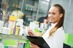 Pharmacy chemist woman in drugstore stock photography