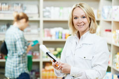 Pharmacy chemist woman in drugstore Stock Images
