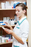 Pharmacy chemist woman with tablets Stock Photography