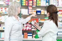 Pharmacy chemist women in drugstore Stock Images
