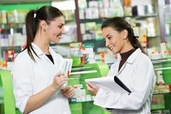Pharmacy chemist women in drugstore Royalty Free Stock Image