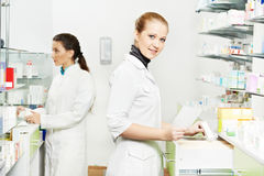 Pharmacy chemist women in drugstore Royalty Free Stock Image