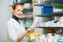 Pharmacy chemist women in drugstore Royalty Free Stock Photos