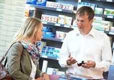 Pharmacy chemist workers in drugstore Stock Image