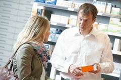 Pharmacy chemist workers in drugstore Stock Photo