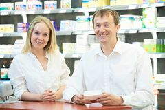 Pharmacy chemist workers in drugstore Stock Images