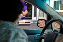 Pharmacy Drive Thru Customer Paying for Medication