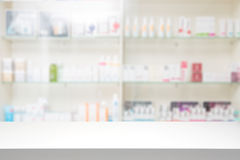 Pharmacy drugstore background concept. Counter store table pharmacy background shelf blurred blur focus drug medical shop drugstore medication blank medicine stock photography