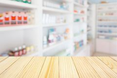 Pharmacy drugstore counter table with blur abstract backbround. With medicine and healthcare product on shelves Stock Photos