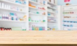Pharmacy drugstore counter table with blur abstract backbround. With medicine and healthcare product on shelves Stock Photography