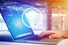 Pharmacy icon going out a laptop interface - technology concept Royalty Free Stock Photography