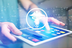 Pharmacy icon going out a tablet interface - technology concept Royalty Free Stock Photos
