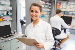 Pharmacy intern smiling at camera Royalty Free Stock Photography