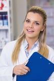 Pharmacy intern smiling at camera Royalty Free Stock Photo