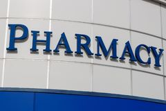 Pharmacy isolated sign, blue letters and white background I stock photos