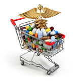 Pharmacy medicine concept. Shopping cart with pills and caduceus Royalty Free Stock Photography
