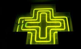 Pharmacy neon green cross Royalty Free Stock Photo