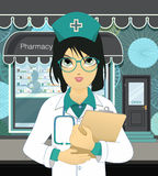 Pharmacy. Pharmacists woman wearing glasses in front of the pharmacy Royalty Free Stock Image