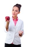 Pharmacy. Pills or apple, two sources of vitamins Stock Image