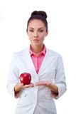 Pharmacy. Pills or apple, two sources of vitamins Stock Photo