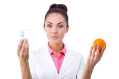 Pharmacy. Pills or fruits, two sources of vitamins Royalty Free Stock Images
