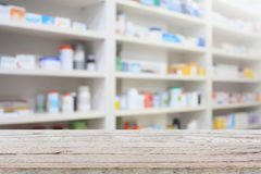 Pharmacy product display counter with drugstore shelves Stock Images