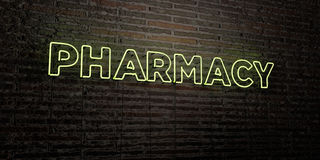 PHARMACY -Realistic Neon Sign on Brick Wall background - 3D rendered royalty free stock image. Can be used for online banner ads and direct mailers royalty free illustration