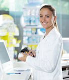 Pharmacy: Scanning a Pill Bottle Stock Images