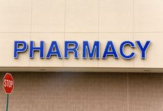 Pharmacy Sign. A large blue pharmacy sign on the outside of a building Stock Photography
