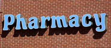 Pharmacy Sign. On side of brick building Royalty Free Stock Images