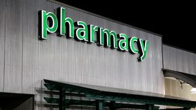 Pharmacy sign on building stock video